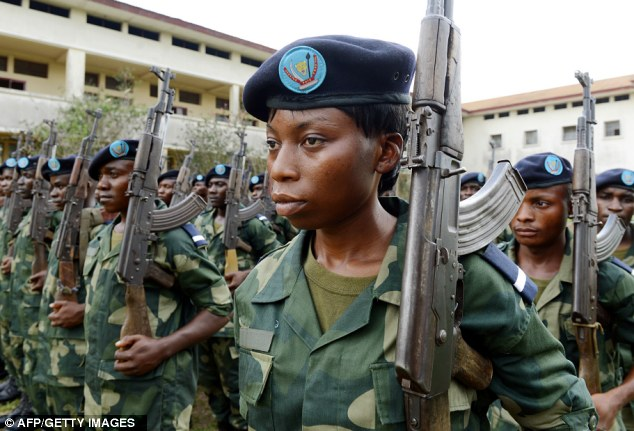 One of the boys: Congolese soldiers attend a decoration ceremony for 89 new lieutenants, including nine women, at a military academy in Kananga in the Democratic Republic of the Congo