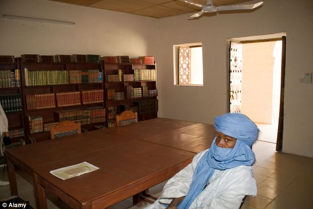 Inside one of Timbuktu's famous libraries: They contain thousands of priceless manuscripts recording genealogies and scientific theories, as well as intellectual arguments between scholars, teachers and commentators
