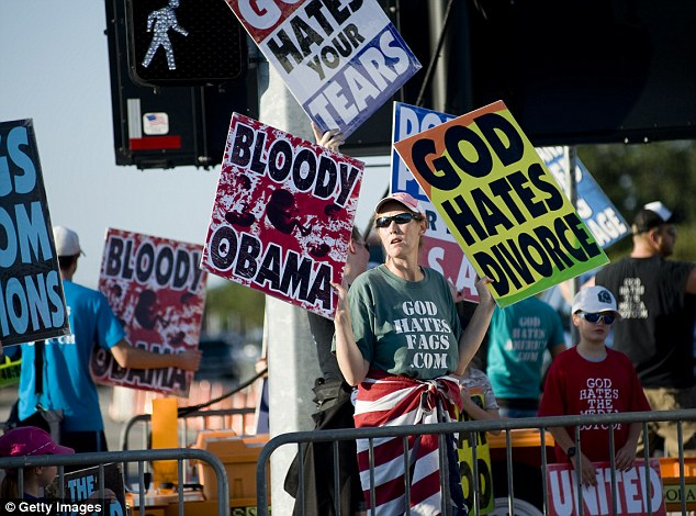 Spreading 'god hate': Members of the Westboro Baptist Church of stage a protest outside a non-denominational prayer and fasting event, entitled The Response, in Houston, Texas