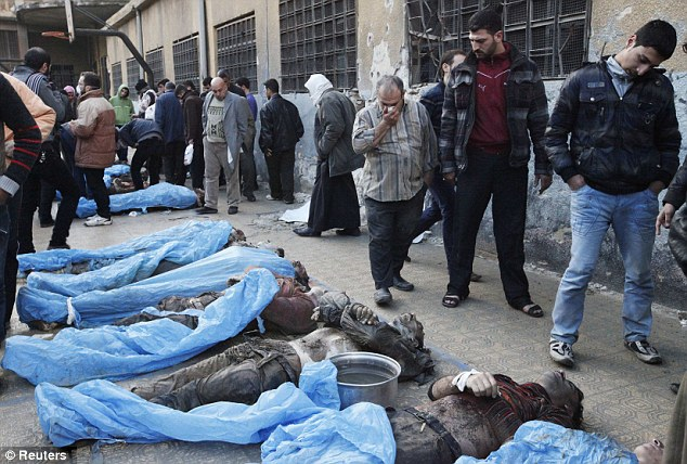 Countless losses: Families attempt to identify the bodies of Syrian fighters shot and dumped in a river in the northern Syrian city of Aleppo today