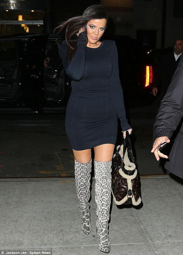 Quick change: Later on Thursday she slipped into a pair of similar Tom Ford boots