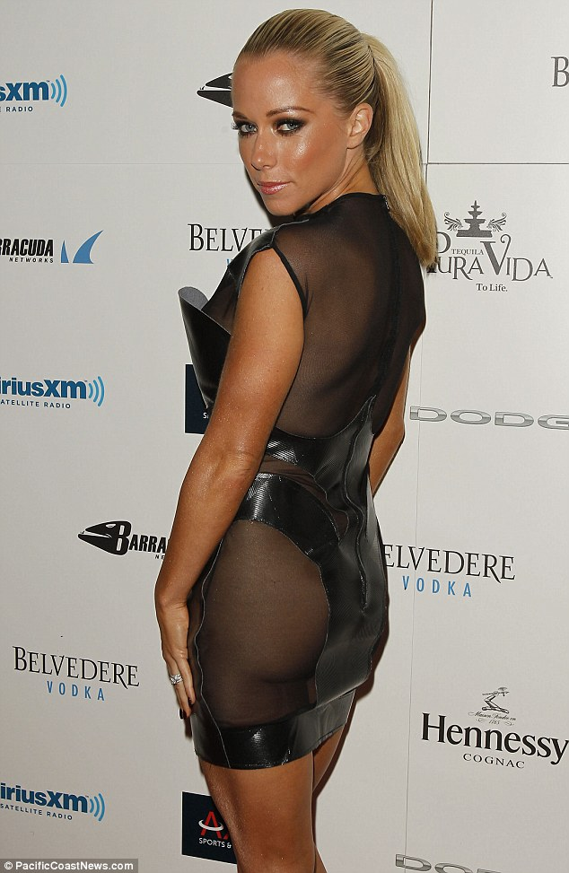 Cheeky! Kendra Wilkinson dared to bare and went without her underwear as she attended the 10th Annual Leather and Laces party on Friday night in New Orleans