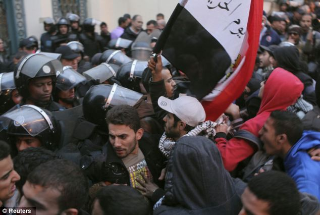 Tussle: Police and protesters scuffle as protesters try to break through a palace gate