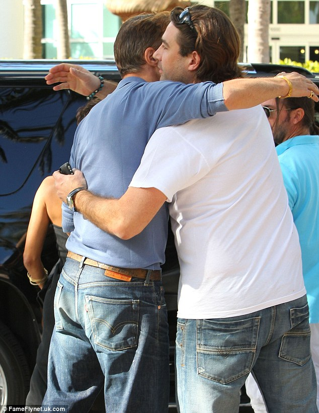Gentleman's hug: Olivier gave a friend a pat on the back before they left