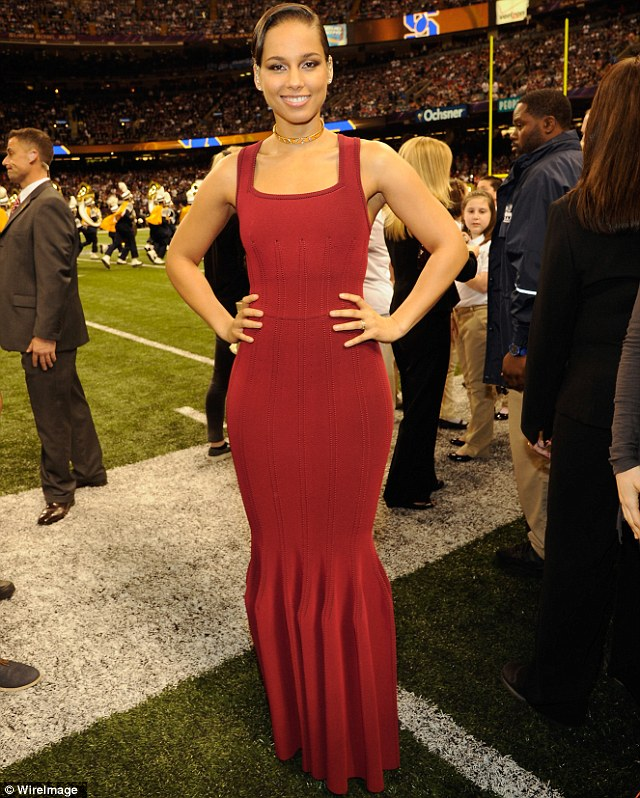 Lady in red: Alicia showed off her svelte figure in the fishtail crimson gown