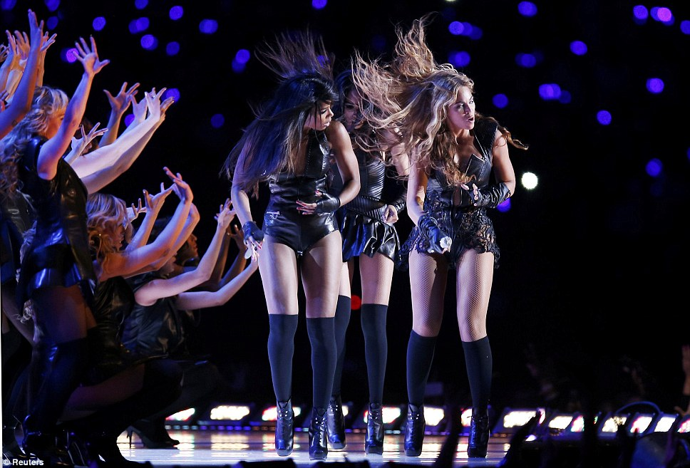 Hair's how: Michelle, Kelly and Beyonce whipped their hair back and forth on stage