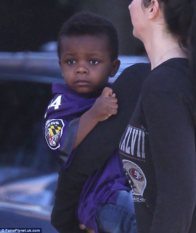 Budding footballer? Louis suited the purple jersey of Baltimore Ravens