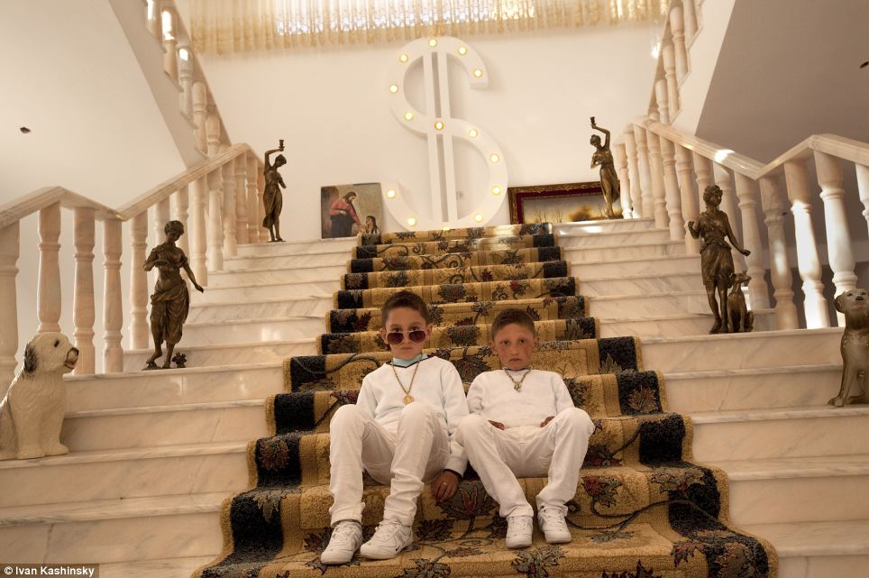 Photographer Ivan Kashinsky was nominated for his work following the ultra-wealthy Roma. This image shows six-year old twins Gelu and Edi Petrache in a mansion on Buzescu, a small town in Romania