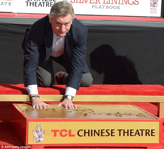Hollywood immortal: Robert De Niro has his hand and footprints taken outside the famous Chinese Theater before heading to the Oscar nominees luncheon in Beverly Hills on Monday morning