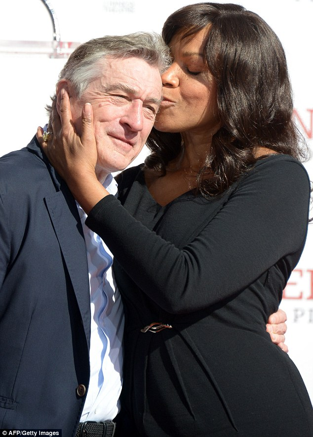 Public display: The happy couple were not afraid to show their affection for one another while standing on the red carpet in Hollywood