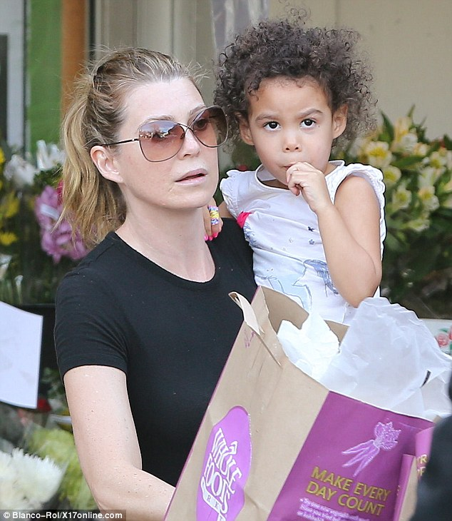 Adorable: It would seem offering little Stella a lollipop was the perfect way to pacify her during the pair' shopping trip