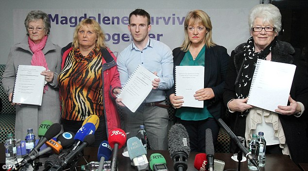 L-R Marina Gambold, Mary Smyth, Steven O'Riordan, Maureen Sullivan and Diane Croghan of Magdalene Survivors Together hold copies of the Government report