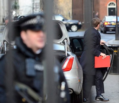 Arriving: The Conservative MP pictured being dropped off at Downing St as his car is searched having just driven the short distance from his office