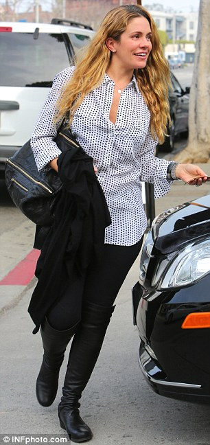 Changing hairdo: Jessica Simpson's best friend wore her hair in a fashionable side braid, only to loosen it for her lunch date