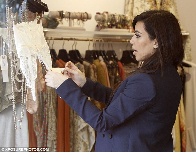 You may need a bigger size! Inside the Curve boutique, a racy lace bralette caught the reality star's eye