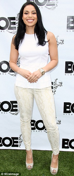 White hot: Jordin Sparks showed off her curves in a pair of snakeskin printed cream trousers and a simple white peplum top as she attended the 1st Annual Grammy Producers Brunch in Los Angeles on Tuesday