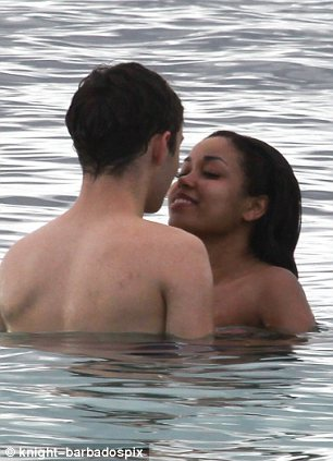 Smooching up a storm: The couple enjoyed a luxury break at the Buccament Bay resort in St Vincent