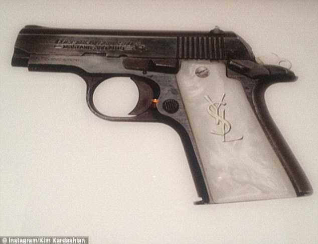 Designer gun: Last year Kim raised a few eyebrows when she tweeted this picture writing 'Bang, bang'