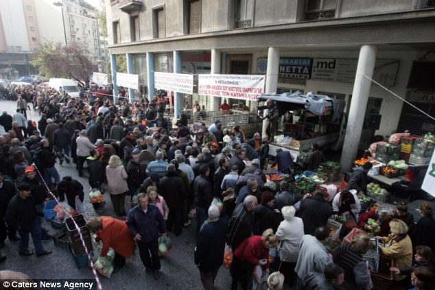 Protest: The farmers want Greece's conservative-led coalition government to reduce the price of fuel, scrap plans to increase taxation on agriculture and cut sales tax on their goods