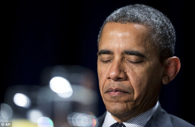 Obama closes his eyes as he listens to offerings of prayers