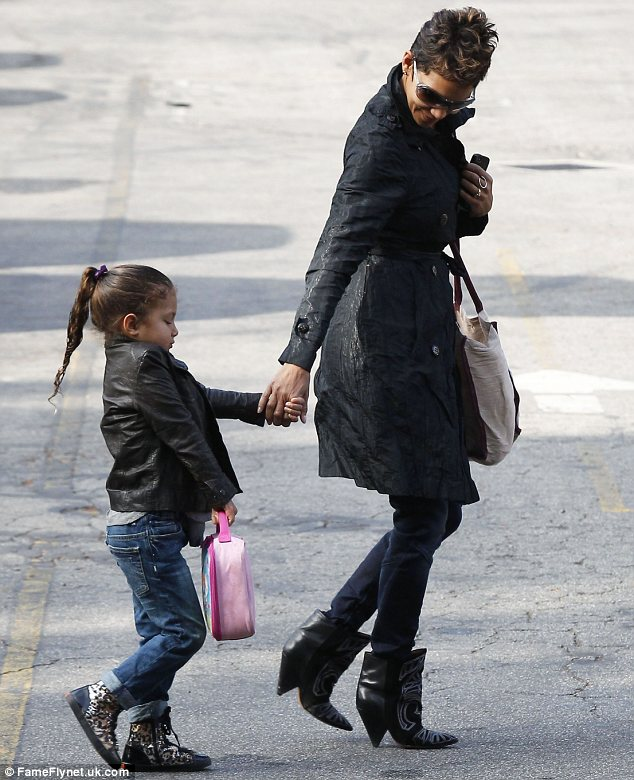 Little tomboy: Nahla appears to be turning to her mother's fiance for fashion tips