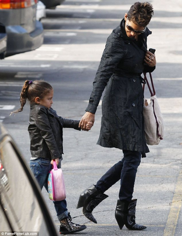 Cute as a button: Nahla, four, looked adorable as she made her way to school in leopard print boots while clutching her lunchbox