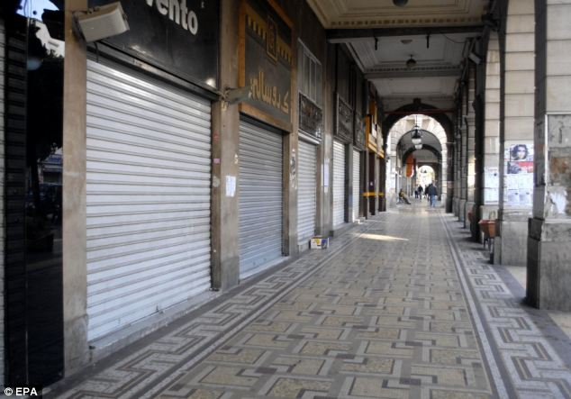 Shut down: Stores are closed during a general strike to coincide with the funeral of Chokri Belaid. It was not clear yet how many people had participated