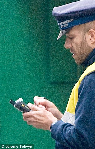Accused: A barber in Liskeard used a loudhailer to alert drivers to the presence of traffic wardens