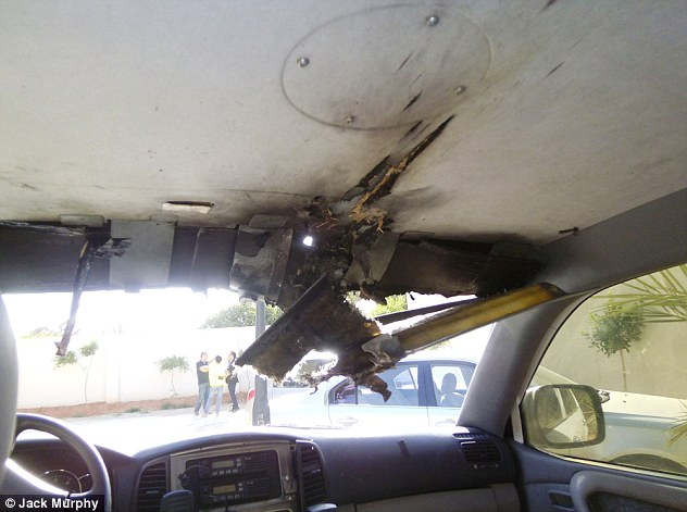 Escalation: The authors pointed a buildup of attacks on western targets in Benghazi before the assault on the consulate. This is the battered wreckage of a British diplomatic security vehicle that was ambushed by militants