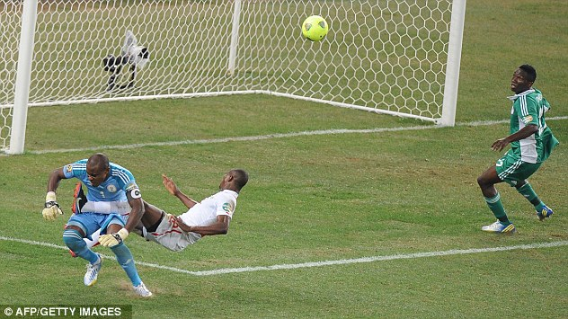 No holds barred: Burkina Faso's Mady Panandetiguiri clashes with Nigeria keeper Vincent Enyeama