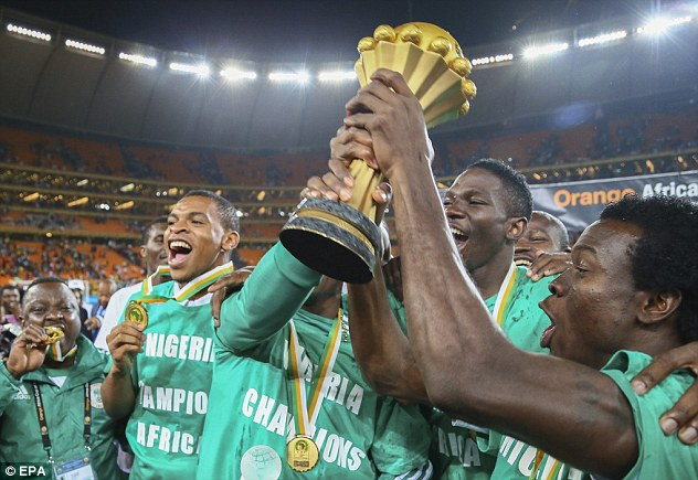 Cup of joy: A jubilant Nigeria squad hoist the Africa Cup of Nations trophy aloft for the third time