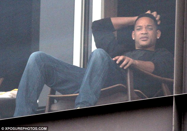 Fancy seeing you here: Will is staying in the same hotel as the power couple and was spotted enjoying a moment on his balcony on Saturday