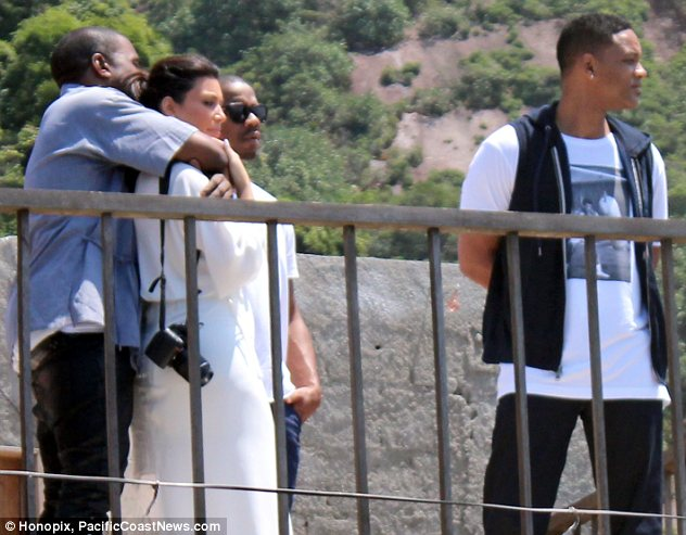 Just can't get enough: Despite the beautiful scenery Kim and Kanye only had eyes for each other