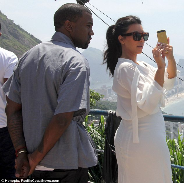 Picture perfect: Kim went through all of Kanye's photos to ensure she was looking her best