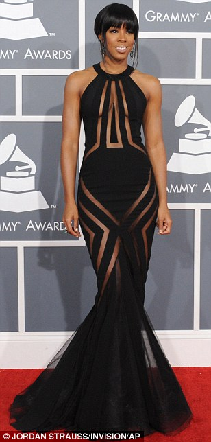 Nearly naked: Kelly Rowland pushed the boundaries in a black dress with sheer panels