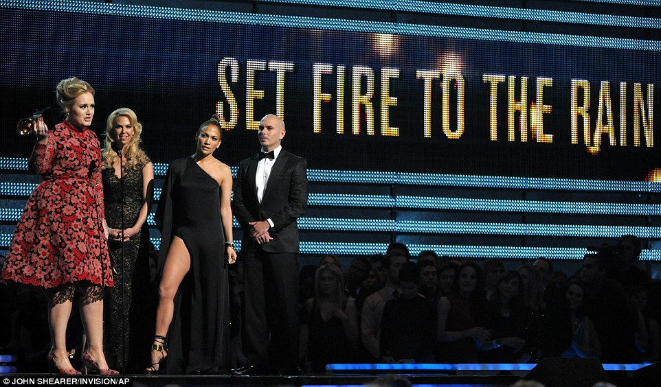 Big moment: Pitbull and J-Lo watch as Adele makes a speech after they present her with the award