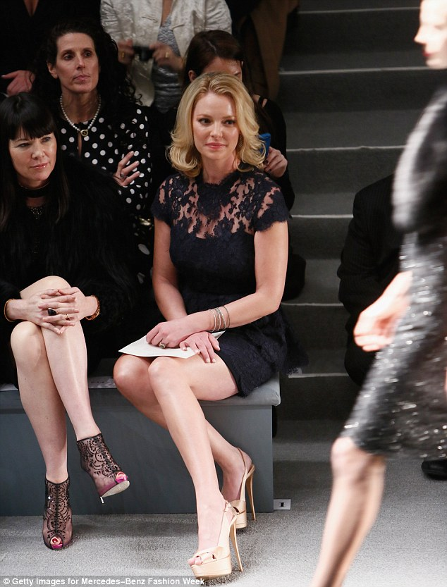 Sitting pretty: Katherine took the front row as she watched the models strut their stuff