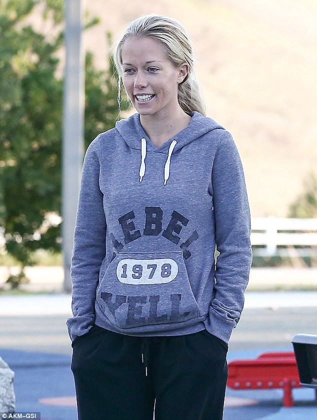 'I'm really thinking in the next couple months': Kendra Wilkinson went make-up free for a family fun day at a Malibu park Monday after revealing that she and Hank Baskett are ready to have another child