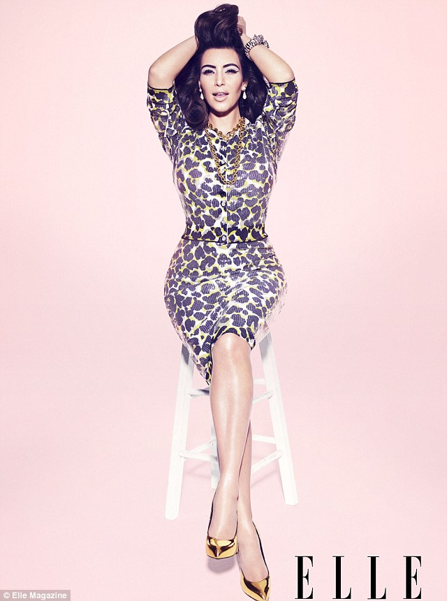 trademark with a twist: Kim looked sultry as she posed in her leopardskin dress and gold shoes