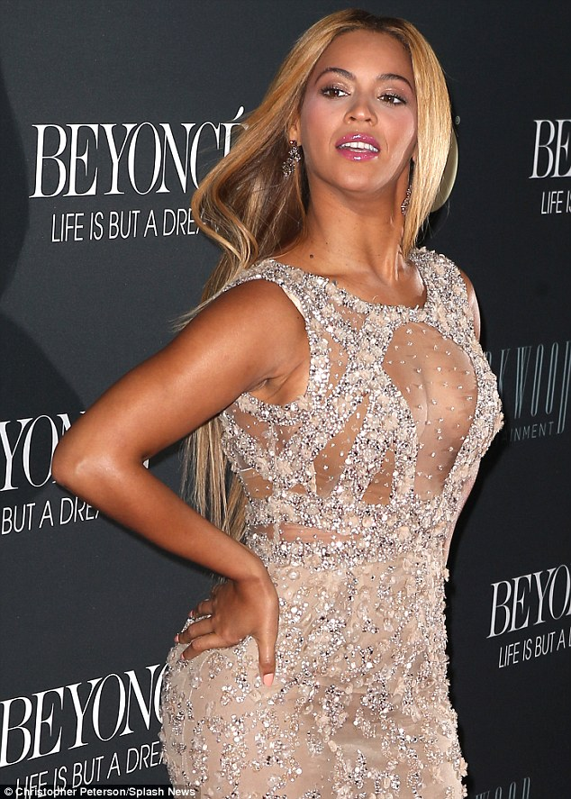 Racy: The pop star's attire featured a transparent panel at the chest and intricate detailing which just managed to cover her modesty