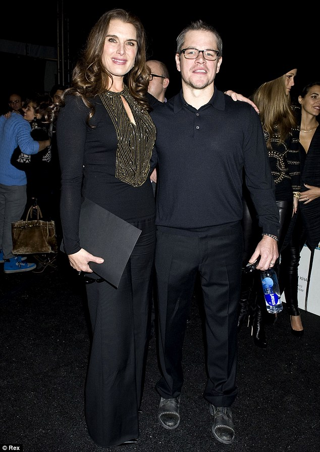 Old friends: Damon also stopped and caught up with the beautiful and towering Brooke Shields