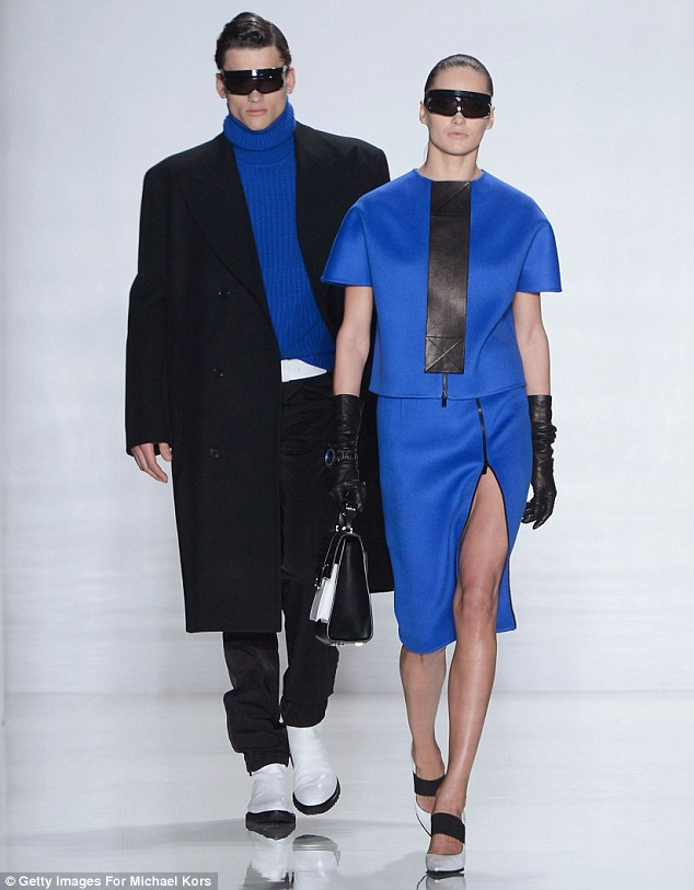 Bold in blue: Models walk the runway at the Michael Kors Fall 2013 fashion show during Mercedes-Benz Fashion Week at The Theatre at Lincoln Center on February 13