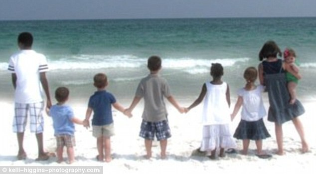 Proud mother: Mrs Higgins' brood pictured on the beach