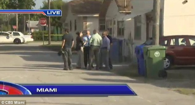 Police at the scene in Miami where Maurice Harris lost his life defending his family