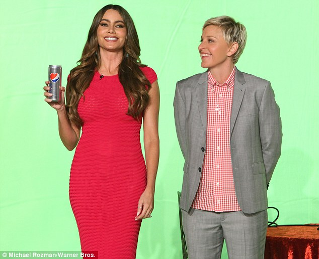 Distraction: Ellen does her best to put Vergara off during the advert