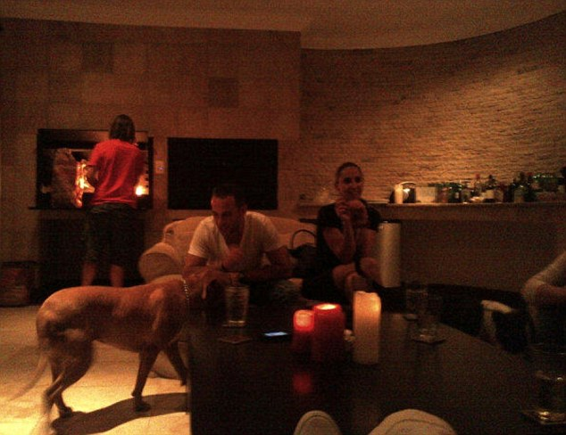 Image: This picture from inside the home shows Oscar and one of his dogs with Reeva Steenkamp at a party with friends