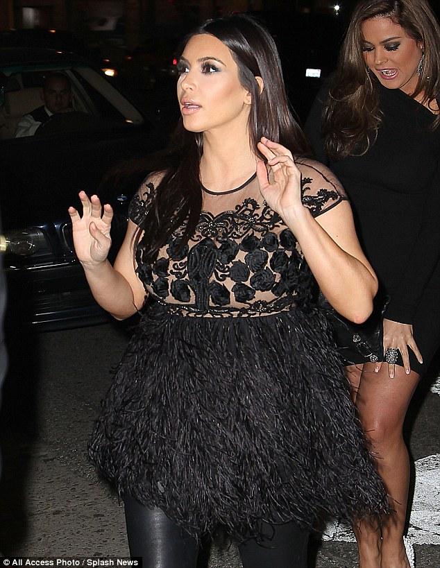 Bumping along: Kim joins the stars at the bash