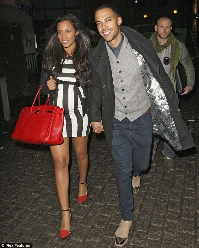 Black and white: Rochelle Wiseman wore a monochrome dress that hid her baby bump as she attended a surprise birthday for Aston Merrygold on Wednesday in Camden, London