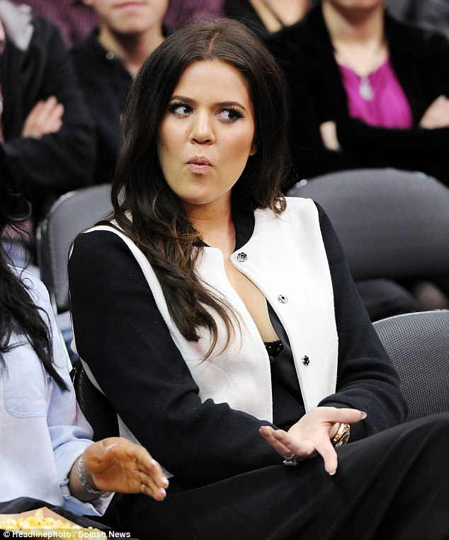 Fashion fan: Khloe watched her husband take on the Houston Rockets but she did it with style