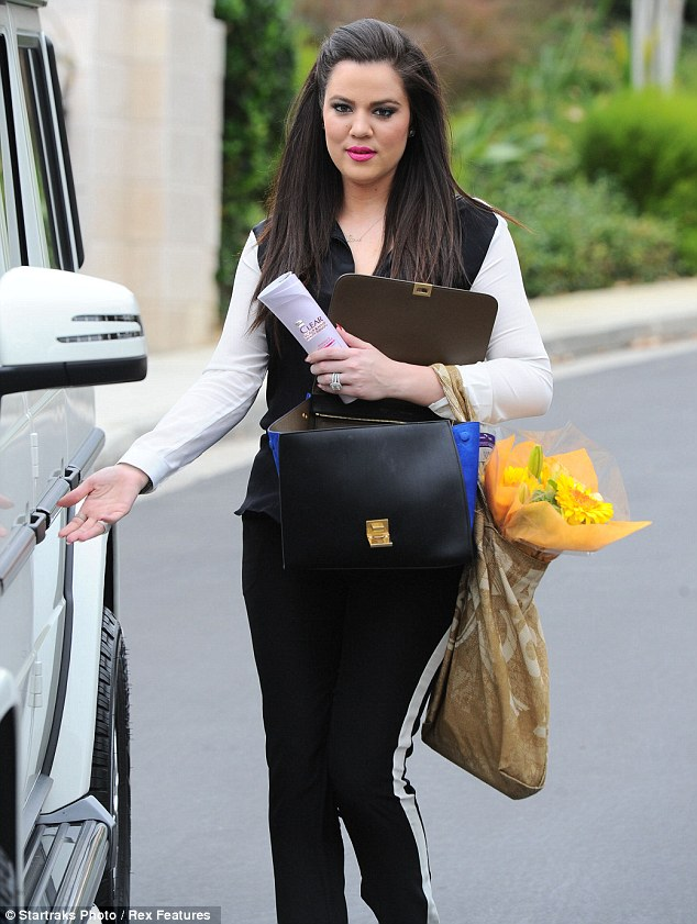 Back to black: Khloe looked beautiful with her long dark hair falling gently over her shoulders